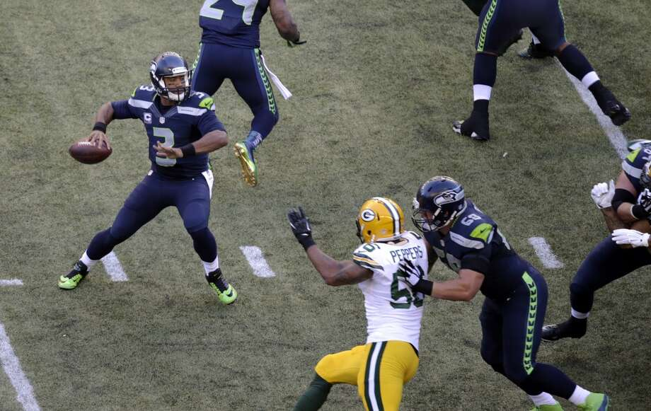 Seattle Seahawks quarterback Russell Wilson (3) looks to pass against the Green Bay Packers during the first half of an NFL football game, Thursday, Sept. 4, 2014, in Seattle. (AP Photo/Scott Eklund) Photo: Scott Eklund, AP