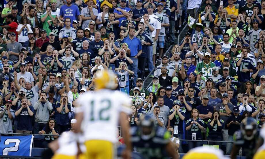 Seattle Seahawks fans yell as Green Bay Packers quarterback Aaron Rodgers (12) tries to call a play in the first half of an NFL football game, Thursday, Sept. 4, 2014, in Seattle. (AP Photo/Scott Eklund) Photo: Scott Eklund, AP