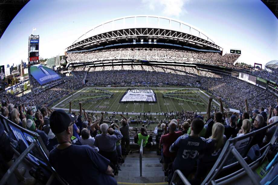 A giant Super Bowl championship banner is unfurled on the field before an NFL football game between the Seattle Seahawks and Green Bay Packers, Thursday, Sept. 4, 2014, in Seattle. (AP Photo/Scott Eklund) Photo: AP