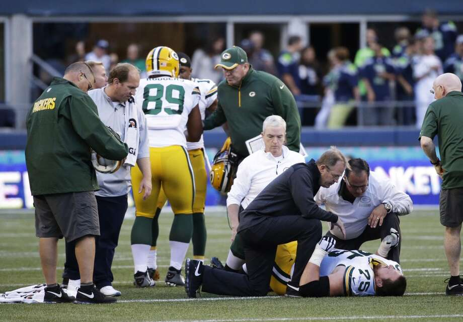 Green Bay Packers Bryan Bulaga (75) lies on the field with an injury during an NFL football game against the Seattle Seahawks, Thursday, Sept. 4, 2014, in Seattle. (AP Photo/Elaine Thompson) Photo: AP