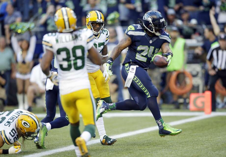 Seattle Seahawks running back Marshawn Lynch (24) scores a touchdown in the first half of an NFL football game against the Green Bay Packers, Thursday, Sept. 4, 2014, in Seattle. (AP Photo/Stephen Brashear) Photo: AP