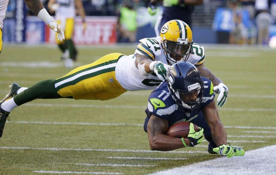 Green Bay Packers free safety Ha Ha Clinton-Dix (21) tackles Seattle Seahawks wide receiver Percy Harvin (11) after a pass reception during the first half of an NFL football game, Thursday, Sept. 4, 2014, in Seattle. (AP Photo/Elaine Thompson) Photo: AP