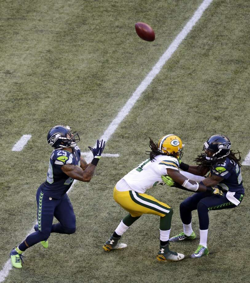Seattle Seahawks' Earl Thomas, left, prepares to catch a punt during the first half of an NFL football game against the Green Bay Packers, Thursday, Sept. 4, 2014, in Seattle. (AP Photo/Scott Eklund) Photo: AP