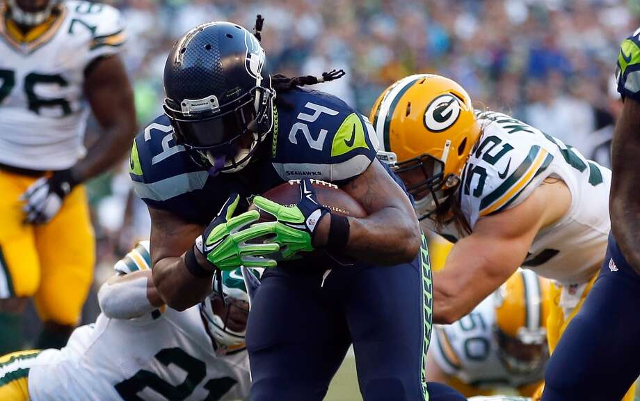 1. Some things never changeWith all the offseason conversation about Russell Wilson, Percy Harvin and the supposedly revamped Seahawks offense, it was an old regular who proved he's still the lynchpin of the Hawks' attack.Marshawn Lynch — who generated less buzz this offseason than Christine Michael, his supposed eventual replacement — ran for 110 yards and two touchdowns on 20 carries (and caught one pass for 14 yards), displaying his trademark physicality and looking fresh after a light workload in the preseason. Wilson and Harvin impressed — more on them in a moment — but Lynch reminded everybody that he is the engine that makes the Seahawks go.The Hawks' ground attack totaled 207 yards on 37 carries and never let the Packers get back in the game once they fell behind. Photo: Otto Greule Jr, Getty Images