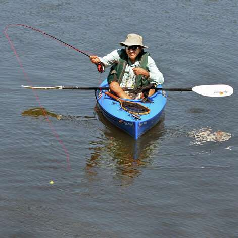 Arnie Schultz of Rotterdam casts a deer hair popper for smallmouth bass in the Mohawk River Sept. 4, 2014, in Rexford, NY.  (John Carl D'Annibale / Times Union) Photo: John Carl D'Annibale
