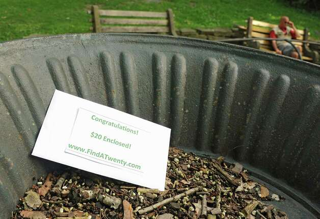 An envelope containing a $20 bill is seen in a flower pot in Congress Park that Leo Quinn of Ballston Spa put there on Thursday, Sept. 4, 2014 in Saratoga Springs, N.Y. Quinn hides $20 bills somewhere in the Capital District and then post a clue and photo to the Find A Twenty Facebook page. (Lori Van Buren / Times Union) Photo: Lori Van Buren / 00028476A