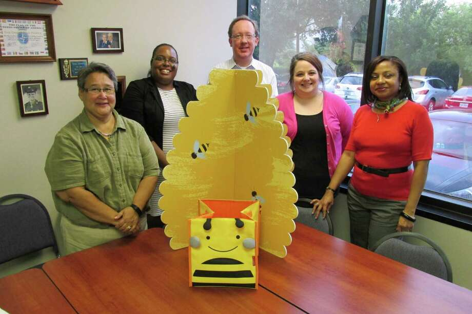 Admiring one of the four bee hives that will be used in decorating for the event at the University of Houston - Sugar Land, are Hive Committee members, from left, Pamela Bergeron, Inez Jackson, David Timmermeyer, Stacie Janak and Jenetha Jones.  Bergeron and Jones are chairing the Great Grown-Up Spelling Bee, presented by Center Point Energy. Photo: Courtesy Literacy Council Of FBC