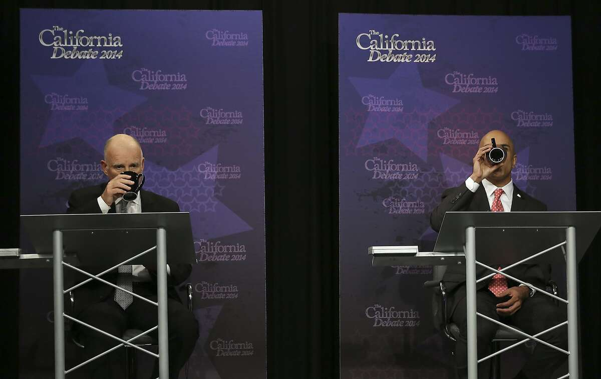 Gov. JerryBrown, left, and Republican challenger Neel Kashkari drink out of their cups during a gubernatorial debate in Sacramento, Calif., Thursday, Sept. 4, 2014.