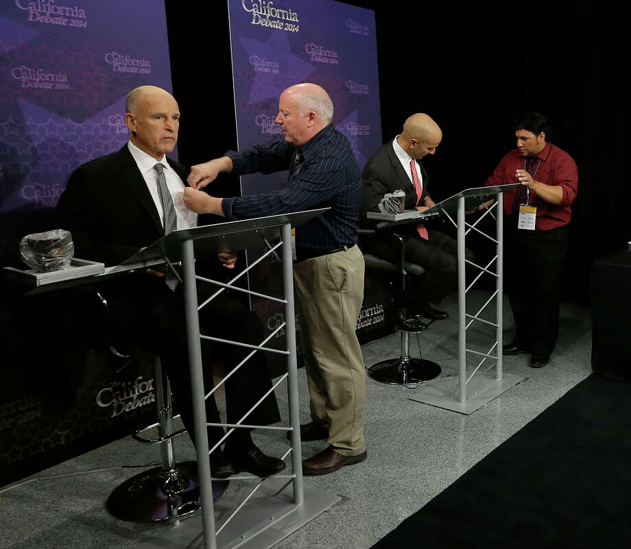 Gov. Jerry Brown (left) and Republican challenger Neel Kashkari (third from left) prepare for their gubernatorial debate in Sacramento. Photo: Rich Pedroncelli, POOL / Associated Press / AP POOL