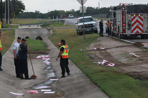 Firefighters from the Bexar Bulverde Volunteer Fire Department clean up a 200 gallon gasoline spill Friday September 5, 2014 at Blanco Road and Midnight. Deputy  Fire Chief Tom White said a tanker truck from Alexander trucking based in Seguin was offloading unleaded gasoline at a Valero station before 9:00 a.m. when a hose bacame disconnected and 200 gallons of fuel flowed into a concrete culvert. The San Antonio Fire Department also responded to the incident. White said absorbent pads, kitty litter and a petrochemical enzyme was used to remediate the spill. There were no injuries and Blanco road was closed for about an hour. White said the Texas Commission on Environmental Quality would be notified about the spill.