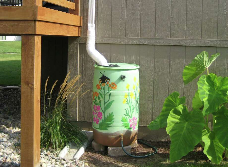 Rain barrels will be the focus of a workshop on Sept. 27. The event is sponsored by Stone Oak Property Owners Association and water interests. Photo: Associated Press File Photo / Alice Snider