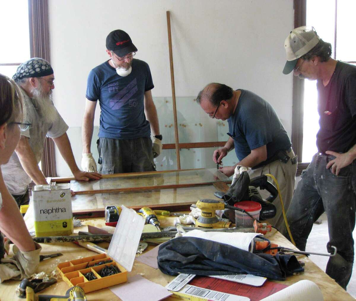 Participants in an Office of Historic Preservation workshop learn historic window repair from local craftsman Victor Salas. Another workshop is planned for Sept. 27.