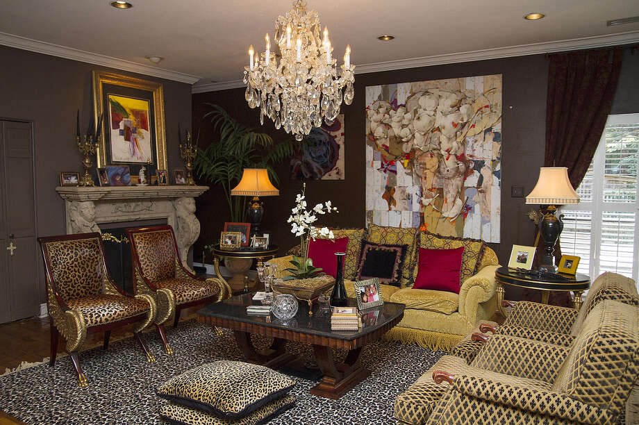 """""""Dark and rich and goopy"""" is how Ric Marmolejo describes his aesthetic, with its dark walls, gilded accents, animal prints and crystal chandeliers. Photo: Photos By Alma Hernandez / For The Express-News"""