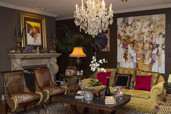 """""""Dark and rich and goopy"""" is how Ric Marmolejo describes his aesthetic, with its dark walls, gilded accents, animal prints and crystal chandeliers."""