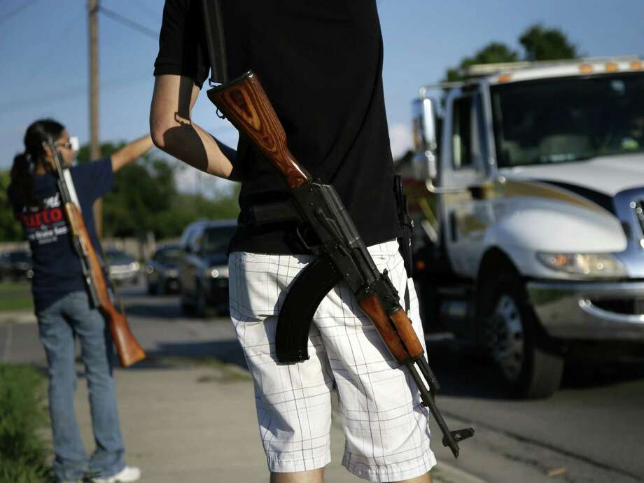 Open carry advocates such as these in Haltom City say their display of firearms discourages crime. But when everyone is armed, how do we tell the good guys from the bad guys? Photo: Tony Gutierrez, Associated Press / AP