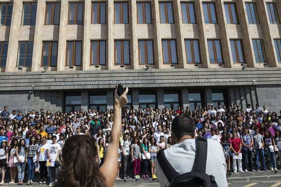 Incoming undergraduate students at the American University of Armenia(AUA), gather on campus steps for a group photo on orientation day on Aug. 27, 2014 in Yerevan, Armenia. The undergraduate program at AUA, only in its second year, has 394 newly enrolled students.