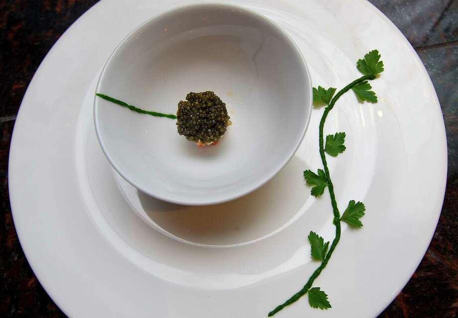 What to eat/drinkAt $250 per ounce the Kaluga caviar at Tony's is the priciest caviar option on the restaurant's tasting menu. (Pictured is the spoonbill caviar and lobster.) Photo: Karen Warren, Houston Chronicle / © 2011 Houston Chronicle