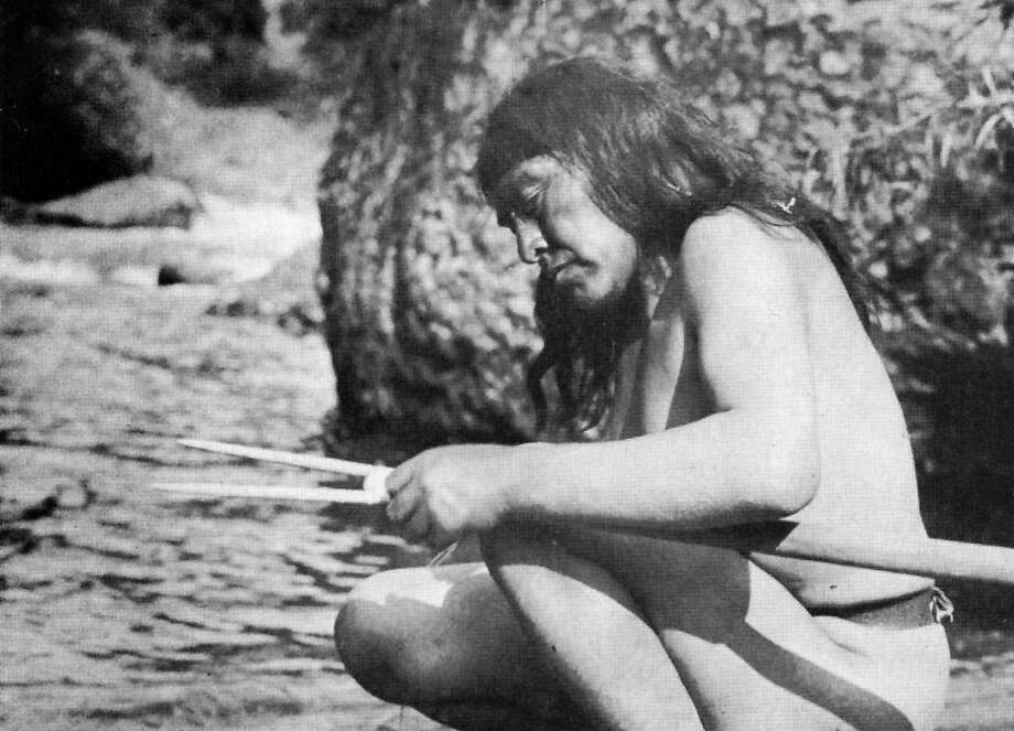 Ishi, the sole surviving member of California's Yahi people, who were wiped out by white settlers in the late 1800s, makes a harpoon in 1914. Photo: Handout, HANDOUT