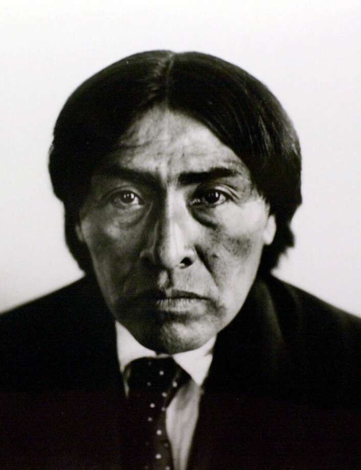 "FILE--An Indian known as Ishi is shown in this July 1912 portrait made in San Francisco.  Nearly 90 years after an Indian known as Ishi walked out of the wilderness and was put on display as the ""Last Wild Man in North America,"" his brain is being brought back home from the Smithsonian Institution to California for a proper burial. (AP Photo/Phoebe Hearst Museum of Anthropology/UC Berkeley Regents, E.H. Kemp, File)  Ran on: 11-13-2011 Ishi, the last Southern Yana Indian, wasn't the best singer. Photo: E.H. Kemp, AP"
