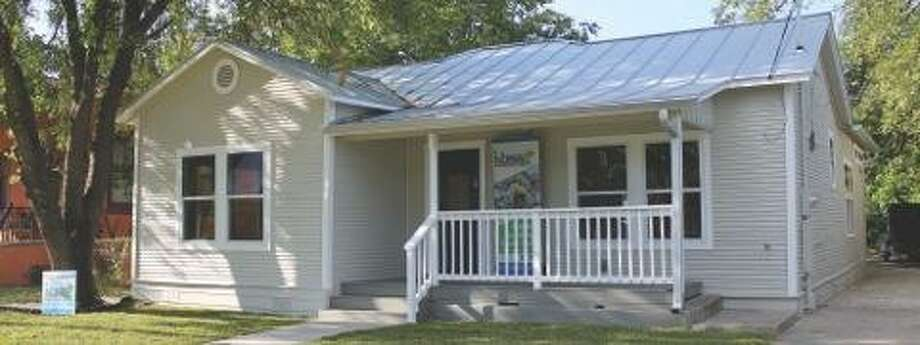 A bungalow at 205 Carolina St. was retrofitted with green features. It is one of six houses featured on the 2014 Green Home Tour, sponsored by Build San Antonio Green. Photo: Courtesy Photo
