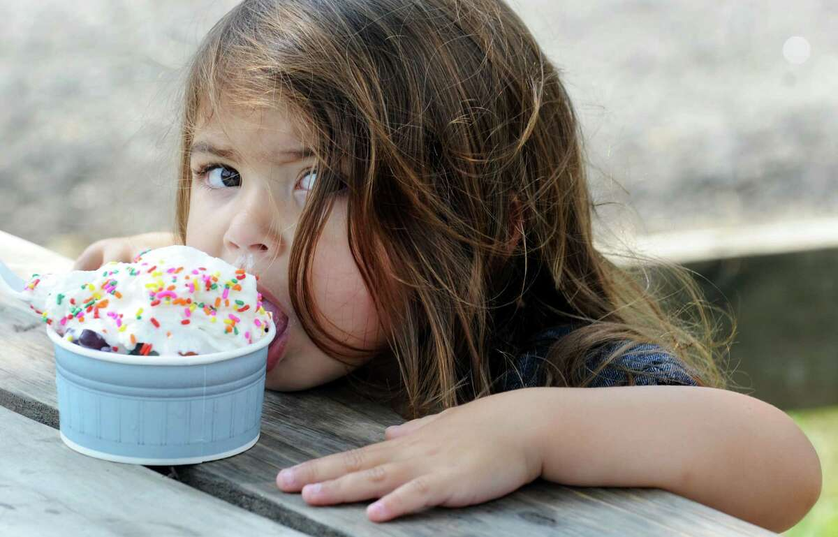 3-year-old Pia Montes enjoys her ice cream at Ferris Acres Farm Creamery in Newtown, Conn. on Friday, September 5, 2014. Pia comes to the farm often with her family, who lives in Monroe and don't mind the 20 minute drive to enjoy this special treat.