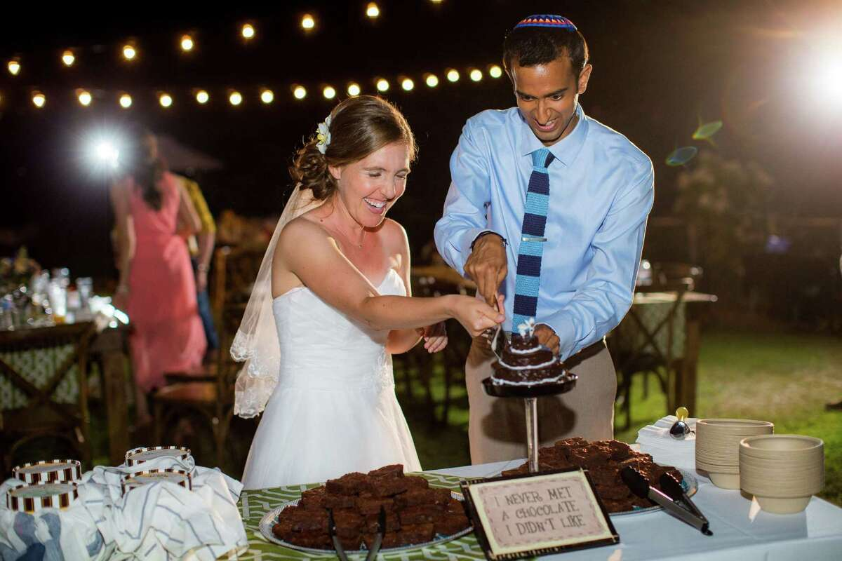 Ruth Tennen and Vijay Narasimhan cut their brownie wedding cake.