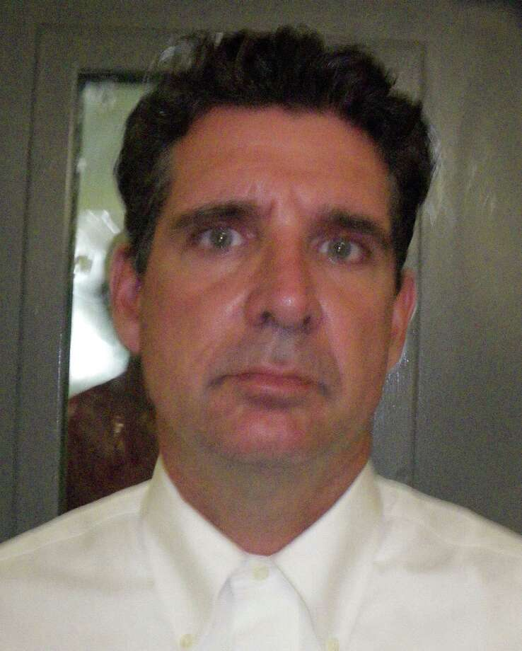 Michael Florio, 49, of Norwalk has been charged with stalking and harassing a former girlfriend in connection with an incident in May. Photo: Westport Police Department / Westport News