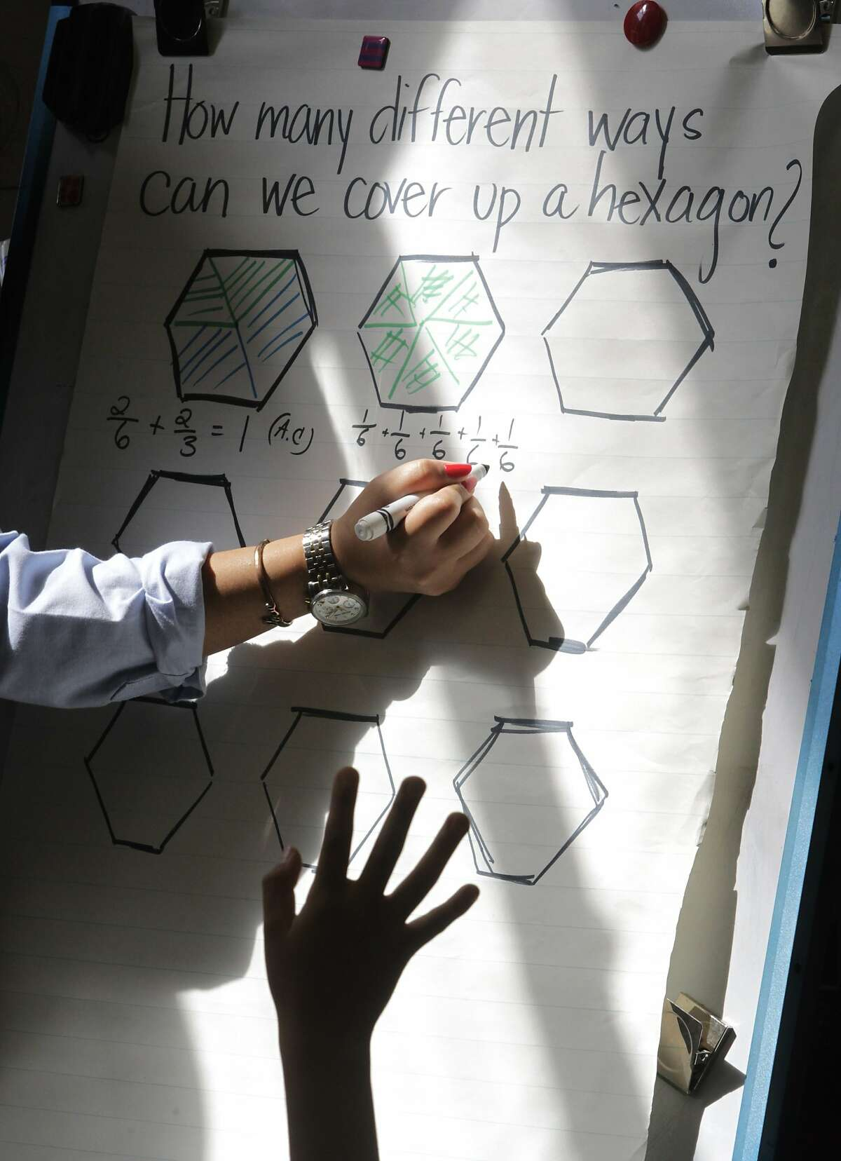 A student (foreground) wants to solve a math equation in Mai-tien Nguyen's 4th grade class at Redding Elementary School in San Francisco, Calif. on Thursday, Sept. 4, 2014. Schools throughout the district are fully implementing the Common Core curriculum this year.