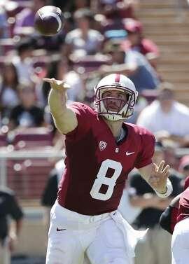 Stanford quarterback Kevin Hogan during an NCAA college football game against UC Davis on Saturday, Aug. 30, 2014, in Stanford, Calif. (AP Photo/Marcio Jose Sanchez)