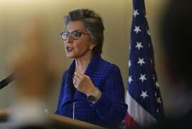 A journalist raises his hand to ask U.S. Senator Barbara Boxer  a  question as she speaks to the media during a press conference at the Ferry Building on Friday, September 5,  2014 in San Francisco, Calif.