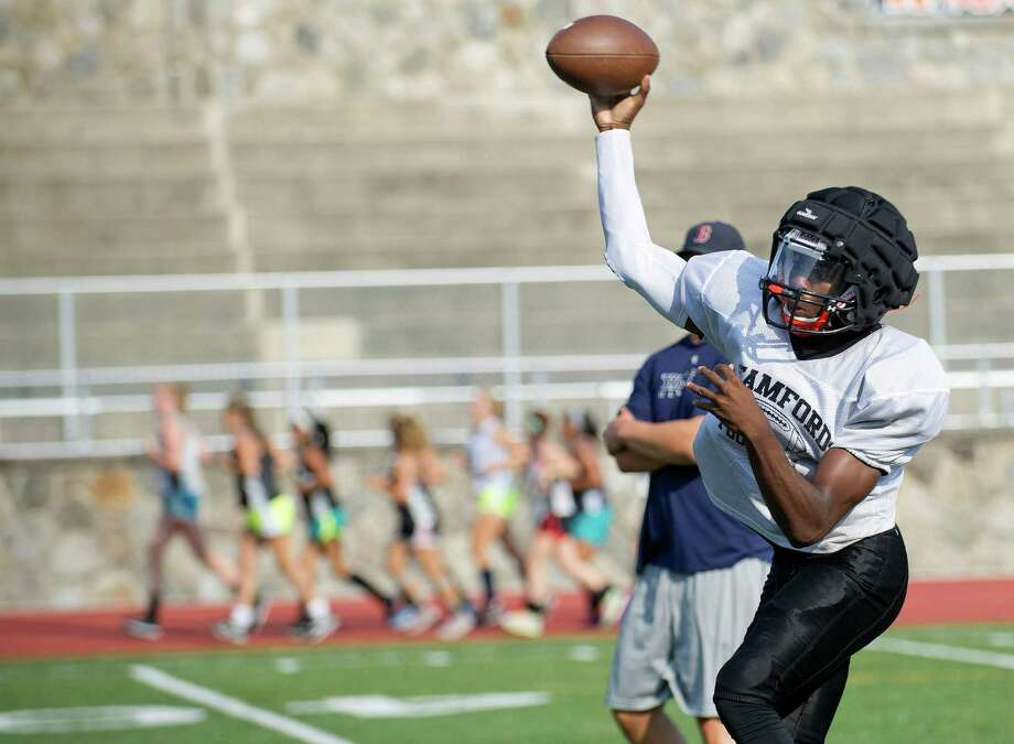 Jalen Brown throws a pass during Friday's practice at Stamford High School on September 5, 2014. Photo: Lindsay Perry / Stamford Advocate
