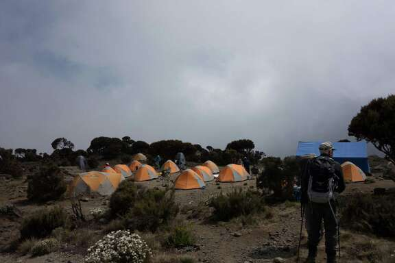 Houstonian Townes Pressler, 78, walks into an  Alpine Ascents International camp on Mount Kilimanjaro.