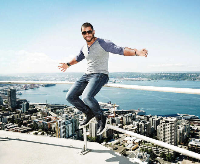 Russell Wilson Poses On Top Of The Space Needle For Men S