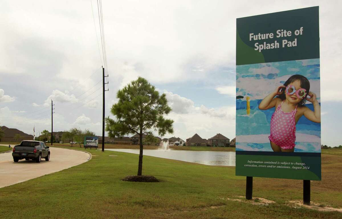 Sign in Canyon Lakes West has some homeowners concerned that developers are downsizing their recreational plans for the master-planned community in Cypress.