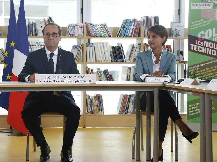 President Francois Hollande and newly appointed Education Minister Najat Vallaud-Belkacem attend a discussion Tuesday, the first day of the new school year, at a  secondary school  near Paris. Photo: Photos By Etienne Laurent / Associated Press / EPA POOL