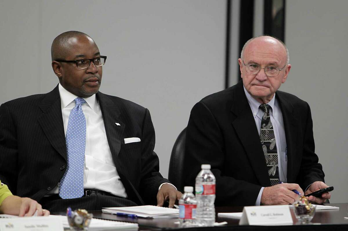 Houston Community College Board Members Carroll Robinson left, and Dave Wilson during this week's HCC board meeting Thursday, Jan. 16, 2014, in Houston. ( James Nielsen / Houston Chronicle )