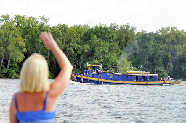 Patti Preston-Schwartz of Albany waves to the Urger during a parade of tugboats on their way to the Tugboat Roundup on Friday, Sept. 5, 2014, in Albany, N.Y. (Cindy Schultz / Times Union) The annual festival is at the Waterford Visitor's Center in Waterford on Saturday and Sunday. Photo: Cindy Schultz / 00028381A