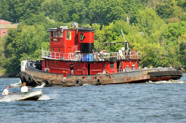 The Cornell passes a skiff during a parade of tugboats on their way to the Tugboat Roundup on Friday, Sept. 5, 2014, on the Hudson River in Albany, N.Y. (Cindy Schultz / Times Union) The annual festival is at the Waterford Visitor's Center in Waterford on Saturday and Sunday. Photo: Cindy Schultz / 00028381A
