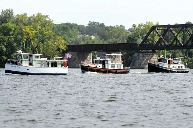Tugboats parade on the Hudson River on their way to the Tugboat Roundup on Friday, Sept. 5, 2014, in Albany, N.Y. (Cindy Schultz / Times Union) The annual festival is at the Waterford Visitor's Center in Waterford on Saturday and Sunday. Photo: Cindy Schultz / 00028381A