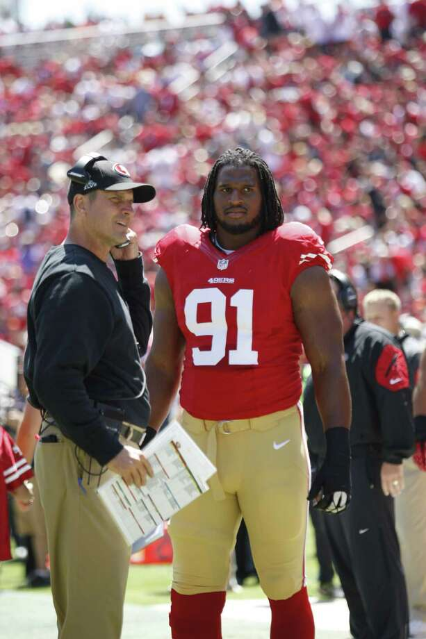 Head coach Jim Harbaugh and the 49ers allowed Ray McDonald to play this season after he was arrested on suspicion of felony domestic violence Aug. 31. McDonald's tenure with S.F. ended Wednesday. Photo: Michael Zagaris / Getty Images / ONLINE_CHECK