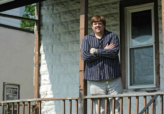 "Nick Lansing, who starred in a reality TV show, ""Fat Guys in the Woods,"" that airs Sunday night on The Weather Channel, stands outside his home Friday, Sept. 5, 2014 in Menands, N.Y. (Lori Van Buren / Times Union) Photo: Lori Van Buren / 00028459A"