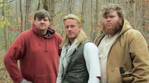 "Nick Lansing, left, joins survival expert, Creek Stewart, center, and another participant, Andrew, of George, in the Weather Channel's new reality TV show, ""Fat Guys in the Woods."" (Photo courtesy the Weather Channel)"