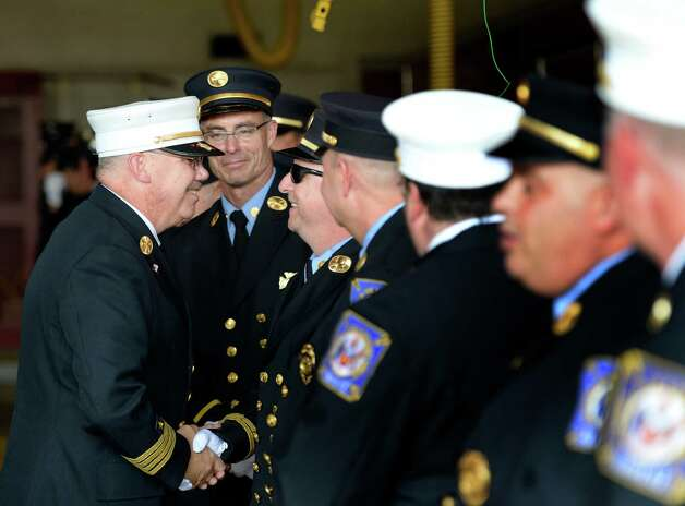 """Deputy Chief Francis """"Skip"""" Nerney shakes hands with members of the Albany Fire Department Friday afternoon Sept. 5, 2014 on the day of his retirement after 27 years in the fire service in Albany, N.Y.      (Skip Dickstein/Times Union) Photo: SKIP DICKSTEIN / 00028488A"""