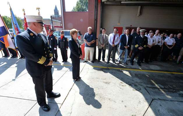 """Deputy Chief Francis """"Skip"""" Nerney, left,  is complimented and thanked for his time with the Albany Fire Department by Mayor Kathy Sheehan Friday afternoon Sept. 5, 2014 on the day of his retirement after 27 years in the fire service in Albany, N.Y.      (Skip Dickstein/Times Union) Photo: SKIP DICKSTEIN / 00028488A"""