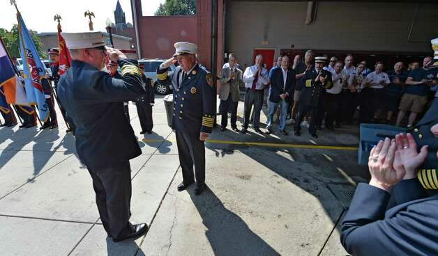 """Chief of Department Warren Abriel, right salutes retiring Deputy Chief Francis """"Skip"""" Nerney, left,  Friday afternoon Sept. 5, 2014 on the day of his retirement from the Albany Fire Department after 27 years in the fire service in Albany, N.Y.      (Skip Dickstein/Times Union) Photo: SKIP DICKSTEIN / 00028488A"""