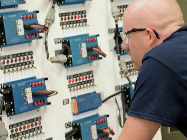 CDTA Technician Sean Kieran looks over a maze of wires, switches and lights and tries to determine problems set up by test proctors during the annual Capital District Transportation Authority's Bus Roadeo held at their garage Friday Sept. 5, 2014 in Albany, N.Y.      (Skip Dickstein/Times Union) Photo: SKIP DICKSTEIN / 00028482A