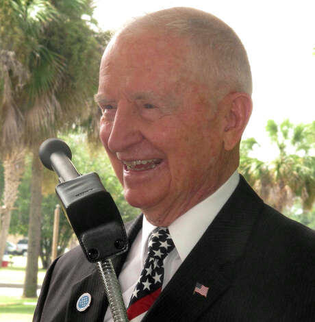 Texas tycoon H. Ross Perot laughs while at the site of the future National Medal of Honor Museum. Photo: Bruce Smith / Associated Press / AP