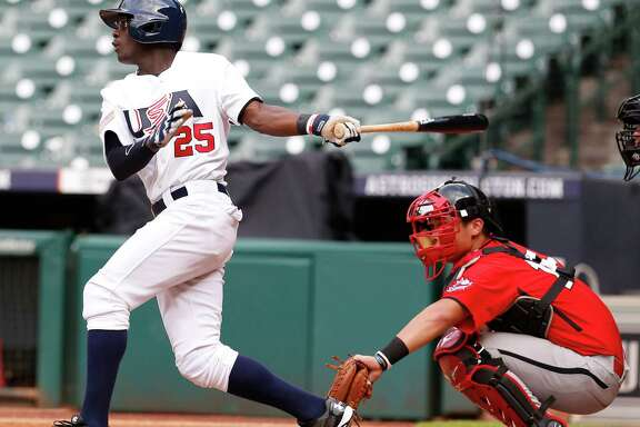 Potential Astros draft pick Daz Cameron, left, liked what he saw of Minute Maid Park when he took his cuts there Monday during USA Baseball's 18-and-under national team's 11-1 victory over Canada.