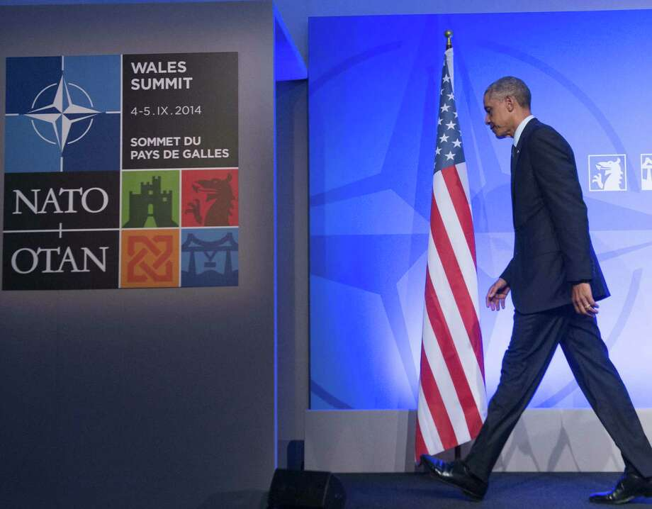 President Barack Obama leaves a news conference at the NATO summit. The U.S. unveiled a military and political campaign against ISIS. Photo: Saul Loeb / Getty Images / AFP