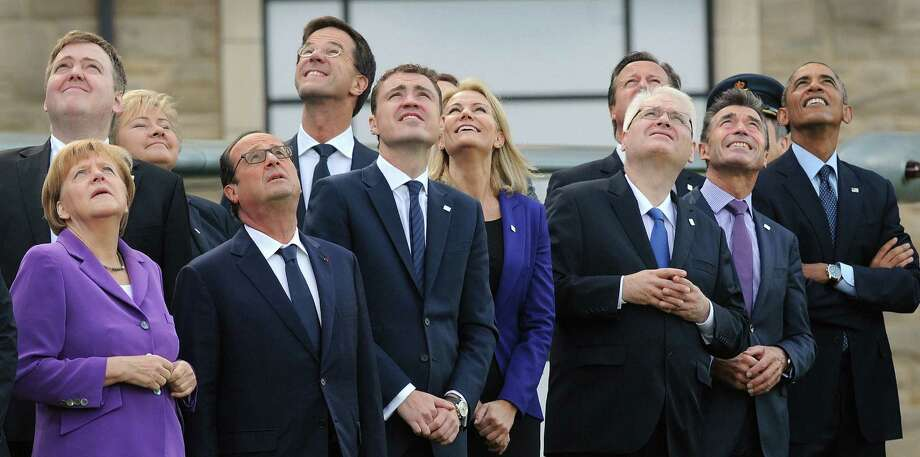 NATO leaders watch a flyover of military aircraft on the second day of their summit at the Celtic Manor Resort in Newport, Wales. They also announced that their next meeting, in 2016, will be held in the Polish capital of Warsaw. Photo: Stefan Rousseau / Getty Images / AFP